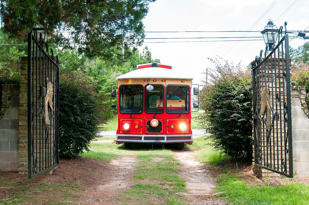 Tour bus parked at the entrance to Cedar Grove Cemetery at Central State Hospital in Milledgeville, Georgia on Saturday, July 17, 2021. Copyright 2021 Jason Barnette