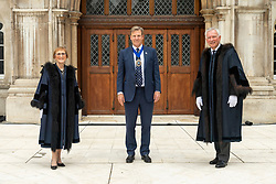 © Licensed to London News Pictures. 24/06/2021. London, UK. Two new Sheriffs of the City of London and Aldermen Alison Gowman (L) Lord Mayor William Russell(C) and Alderman Nicholas Lyons (R) appear at Guildhall Yard wearing full ceremonial dress after being elected at a meeting of Common Hall at Guildhall in the heart of the Square Mile. The position of Sheriff dates back to medieval times and the role includes supporting the Lord Mayor in his or her duties, acting as global for the UK's financial and professional services industry and supporting judges at the Central Criminal Court – the Old Bailey. Photo credit: Ray Tang/LNP