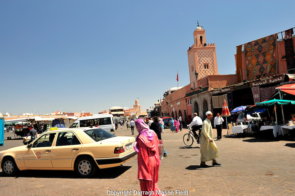 The place remains the main square of Marrakesh, used equally by locals and tourists. During the day it is predominantly occupied by orange juice stalls, youths with chained Barbary apes, water sellers in colourful costumes with traditional leather water-bags and brass cups, and snake charmers who will pose for photographs for tourists[2]. As the day progresses the entertainments on offer change: the snake charmers depart, and in the afternoon and evening the square becomes more crowded, with Chleuh dancing-boys (it would be against custom for girls to provide such an entertainment), story-tellers (telling their tales in Berber or Arabic, to an audience of appreciative locals), magicians, and peddlers of traditional medicines. As dark descends the square fills with dozens of food-stalls, and the crowds are at their height.