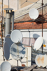 Rooftops apartment buildings TV satellite dish