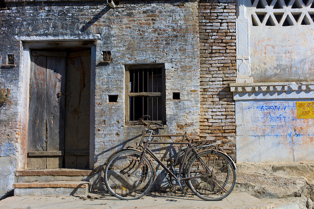 Bicycles propped on old building in Narlai village in Rajasthan, Northern India