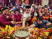 05 FEBRUARY 2019 - BANGKOK, THAILAND: People make Chinese New Year offerings at Wat Mangon Kamalawat, a large Chinese Buddhist temple in Bangkok's Chinatown. Chinese New Year celebrations in Bangkok started on February 4, 2019, although the city's official celebration is February 5 - 6. The coming year will be the Year of the Pig in the Chinese zodiac. About 14% of Thais are of Chinese ancestry and Lunar New Year, also called Chinese New Year or Tet is widely celebrated in Chinese communities in Thailand.      PHOTO BY JACK KURTZ