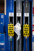 As the fuel transport crisis continues into its second week, sealed Tescos petrol and diesel pumps are covered in a closed petrol and fuel station in south London, on 27th September 2021, in London, England. The shortages at retailers around the country are caused by the UK's lack of qualified HGV (Heavy Goods Vehicles) drivers who deliver supplies to the nation's fuel forecourts, the majority of which are now closed after panic-buying drained fuel stock.