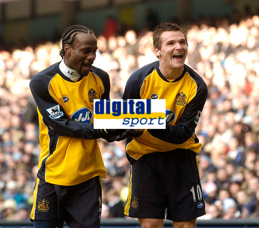 Photo: Jed Wee.<br />Manchester City v Wigan Athletic. The Barclays Premiership. 18/03/2006.<br /><br />Wigan goalscorer Lee McCulloch (R) celebrates his goal with Pascal Chimbonda.