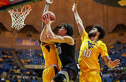 Feb 18, 2019; Morgantown, WV, USA; Kansas State Wildcats guard Mike McGuirl (0) shoots in the lane during the first half against the West Virginia Mountaineers at WVU Coliseum. Mandatory Credit: Ben Queen-USA TODAY Sports