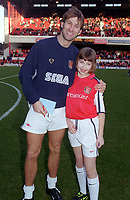 Tony Adams with the Arsenal mascot before the match. Arsenal 5:0 Newcastle United, F.A.Carling Premiership, 9/12/2000. Credit Colorsport / Stuart MacFarlane.