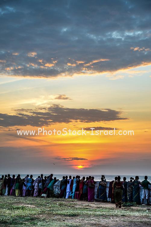 Pilgrims on the beach at Kanyakumari, Tamil Nadu, Southern India at sunset