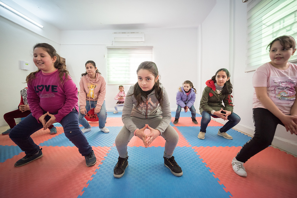 17 February 2020, Zarqa, Jordan: A group of girls participate in a Zumba session for children at the Lutheran World Federation community centre in Zarqa. Through a variety of activities, the Lutheran World Federation community centre in Zarqa serves to offer psychosocial support and strengthen social cohesion between Syrian, Iraqi and other refugees in Jordan and their host communities.