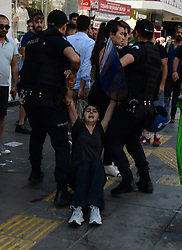 July 23, 2017 - Ankara, Turkey - Turkish policemen detain a protester during a demonstration in support of two hunger-strikers in Ankara, on July 23 2017. The two hunger-strikers, Nuriye Gulmen and Semih Ozakca, were arrested in May. (Credit Image: © Depo Photos via ZUMA Wire)