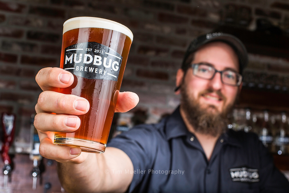 Mudbug Brewery head brewer Leith Adams serves a cold glass of Café Au Lait Stout at the new craft brewery in Thibodaux, Louisiana