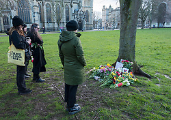 © Licensed to London News Pictures;13/03/2021; Bristol, UK. People lay flowers and notes in remembrance on College Green in memory of woman Sarah Everard whose body was confirmed found in Kent yesterday. A police officer has been charged with her murder. Vigils across the the country had been planned but were cancelled because of the Covid-19 coronavirus pandemic Lockdown restrictions in England. Photo credit: Simon Chapman/LNP.