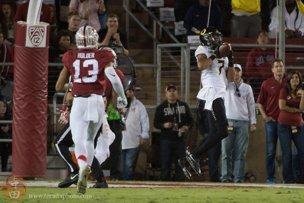 November 14, 2015; Stanford, CA, USA; Oregon Ducks wide receiver Darren Carrington (7) catches a touchdown pass against Stanford Cardinal cornerback Alijah Holder (13) during the second quarter at Stanford Stadium.