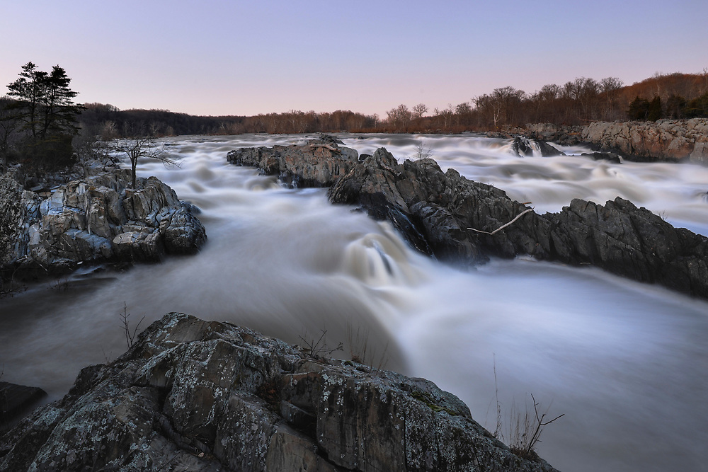 Located 14 miles upstream from DC, Great Falls lies along the Atlantic Seaboard Fall Line where the Piedmont Plateau meets the Atlantic Coastal Plain. The series of cascades descend a total of 76 feet over less than a mile, making it the steepest fall line rapids of any river on the Eastern Seaboard. The falls themselves were created over thousands of years dating from the last ice age when the sea level dropped, resulting in the Potomac carving deep into the surrounding rock as it made its way to the Chesapeake.