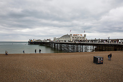 © Licensed to London News Pictures. 17/04/2017. Brighton, UK. Few people can be seen on the beach in Brighton as clouds and cold weather are hitting the seaside resort on the Easter bank holiday Monday. Photo credit: Hugo Michiels/LNP