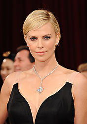 March 2, 2014 - Hollywood, California, U.S. - Actress CHARLIZE THERON wearing a Dior gown, arrives at the 86th Academy Awards held at the Dolby Theater.  (Credit Image: © Lisa O'Connor/ZUMA Wire/ZUMAPRESS.com)