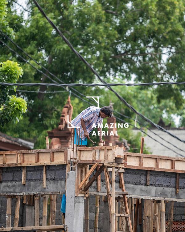 Bali, Indonesia - 22 March 2019: View of people working on Bali Island, Indonesia.
