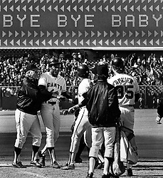 Giants Bobby Bonds greeted after 11th inning walkoff HR against the Braves. Greeted by Mgr. Charlie Fox and teamates. (photo 1973 Ron Riesterer)