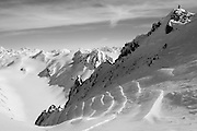 """Jeff Dostie stands atop """"Shakedown Street"""" in the Chugach Range during the first ascent and descent.<br /> <br /> Photo by David Stubbs © 2012"""