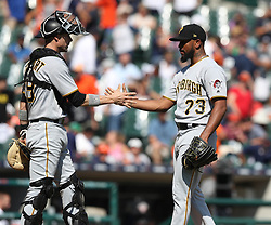 August 10, 2017 - Detroit, MI, USA - Pittsburgh Pirates pitcher Felipe Rivero (73) and catcher Chris Stewart shake hands after the final out in a 7-5 win against the Detroit Tigers on Thursday, Aug. 10, 2017, at Comerica Park in Detroit. (Credit Image: © Kirthmon F. Dozier/TNS via ZUMA Wire)