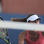 Martin Hingis, Switzerland, during her doubles match with partner Daniela Hantuchova, Slovakia, against Sara Errani and Roberta Vinci, ITaly, during the Women's Doubles competition at the US Open. Flushing, New York, USA. 30th August 2013. Photo Tim Clayton