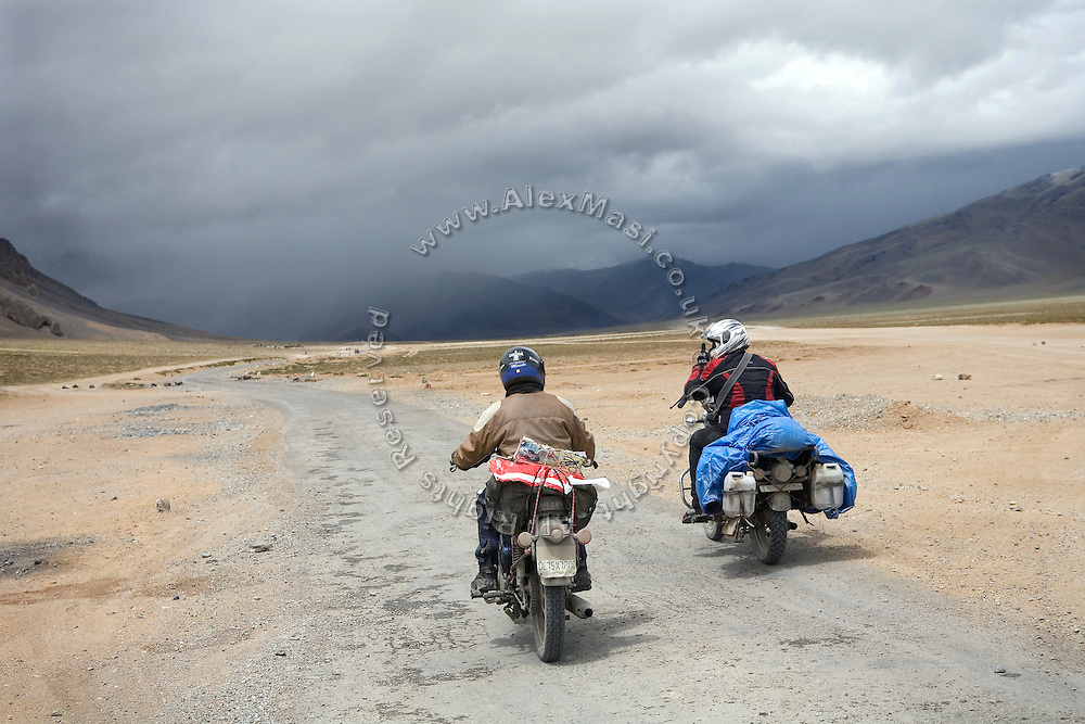 Two adventurous bikers are about to enter a hail storm along the More Plains, a part of the Leh-Manali Highway.