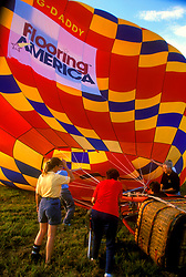 Stock photo of women preparing a hot air balloon for takeoff at Houston's Balloonar Festival