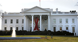Dec. 4, 2013 - Washington, District Of Columbia, U.S - A huge red ribbon hangs on the North Portico of the White  House in Washington, D.C. for World AIDS Day, Tuesday,  December 1, 2013. (Credit Image: © Prensa Internacional/ZUMAPRESS.com)
