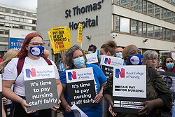London, UK. 30th July, 2021. NHS staff prepare to march from St Thomas' Hospital to Downing Street to protest against the NHS Pay Review Body's recommendation of a 3% pay rise for NHS staff in England. The protest march was supported by Unite the union, which has called on incoming NHS England Chief Executive Amanda Pritchard to ensure that a NHS pay rise comes from new Treasury funds rather than existing NHS budgets and which is shortly expected to put a consultative ballot for industrial action to its members.