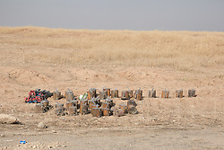 Licensed to London News Pictures. 23/10/2016. Harvested improvised explosive devices, laid by the Islamic State during their two year occupation of the Bartella area of Iraq, wait for disposal by the side of the Erbil to Mosul road.<br /> <br /> Bartella, a mainly Christian town with a population of around 30,000 people before being taken by the Islamic State in August 2014, was captured two days ago by the Iraqi Army's Counter Terrorism force as part of the ongoing offensive to retake Mosul. Although ISIS militants were pushed back a large amount of improvised explosive devices are still being found in the town's buildings. Photo credit: Matt Cetti-Roberts/LNP