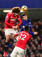 Marouane Fellaini of Manchester United (l) jumps for a header with Alvora Morata of Chelsea (r).   .Premier league match, Chelsea v Manchester United at Stamford Bridge in London on Sunday 5th November 2017.<br /> pic by Andrew Orchard sports photography.
