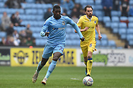 Coventry City striker Amadou Bakayoko (21) sprints forward with the ball during the EFL Sky Bet League 1 match between Coventry City and Bristol Rovers at the Ricoh Arena, Coventry, England on 7 April 2019.