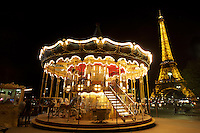 the carousel was really bright compared to the Eiffel tower so i knocked it down using my lens cap.