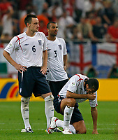 Photo: Glyn Thomas.<br />England v Portugal. Quarter Finals, FIFA World Cup 2006. 01/07/2006.<br /> England's Rio Ferdinand looks dejected.