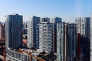 A view of a residential development known as Sanlitun Soho in Beijing, China, on 10 December 2011. As China's central government shows no intention to loosen its policy restrictions on the housing market despite 4 consecutive  months of price drops,  local governments must find a way to repay the 10.7 trillion yuan ($1.7 trillion) in debt as their land sale revenue dropped 13 percent from the previous year and with no end in sight.