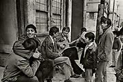 An impromptu music gathering on a Korce street.