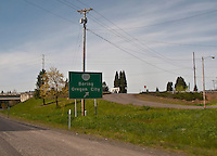 scene along a cross country trip with in a classic Mini Cooper auto - road sign to Boring Oregon City along US 26