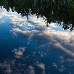 Cloud reflections in Lang Pond in Maine's Northern Forest. Cold Stream watershed, Parlin Pond Township.