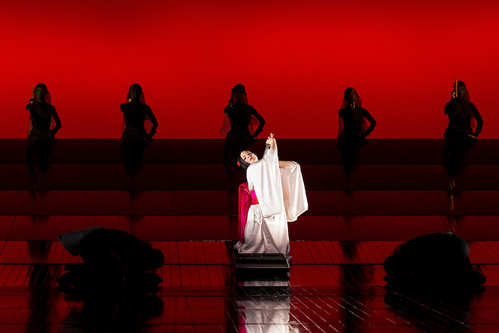"""LONDON, UK, 14 May, 2016. Rina Harms (as Butterfly) rehearses with members of the cast for the revival of director Anthony Minghella's production of Puccini's opera """"Madam Butterfly"""" at the London Coliseum for the English National Opera. The production opens on 16 May. Photo credit: Scott Rylander."""