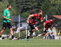 18.07.2013, Trainingsplatz, Walchsee, AUT, 1. FBL, Augsburg Trainingslager, im Bild Paul VERHAEGH (FC Augsburg #2) zieht den Gewichts-Schlitten, Thomas BARTH (Co-Trainer FC Augsburg, li.) // during a Training Session of German Bundesliga Club Augsburg at the Training Ground, Walchsee, Austria on 2013/07/18. EXPA Pictures © 2013, PhotoCredit: EXPA/ Eibner/ Klaus Rainer Krieger<br /> <br /> ***** ATTENTION - OUT OF GER *****