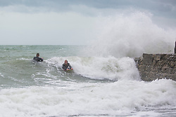 © Licensed to London News Pictures. 04/09/2016. Brighton, UK. A group of surfers is taking advantage of the strong winds and powerful waves to spent time surfing in the Brighton sea. Photo credit: Hugo Michiels/LNP