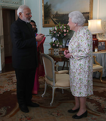 Prime Minster of India Narendra Modi is greeted by Queen Elizabeth II during a private audience at Buckingham Palace, London.