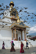 Buddhists circumnavigating Memorial Chorten in prayer, Thimpu, Bhutan