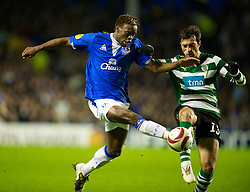 LIVERPOOL, ENGLAND - Tuesday, February 16, 2010: Everton's Louis Saha and Sporting Clube de Portugal's Tonel during the UEFA Europa League Round of 32 1st Leg match at Goodison Park. (Photo by: David Rawcliffe/Propaganda)