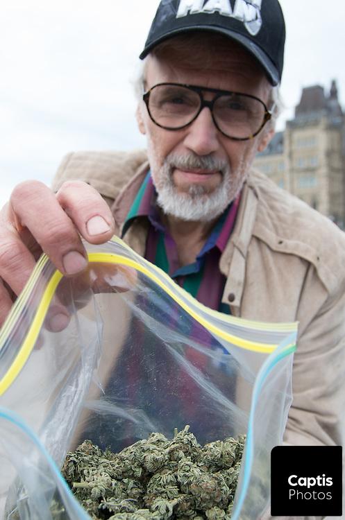 Raymond Turmel holds open his bag containing medical marijuana. April 20, 2014.