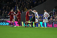 Football - 2018 / 2019 Premier League - Brighton and Hove Albion vs. Liverpool<br /> <br /> Andrew Robertson of Liverpool protests over a throw in as Anthony Knockaert of Brighton explains to James Milner of Liverpool about who kicked the ball out of play at The Amex Stadium Brighton <br /> <br /> COLORSPORT/SHAUN BOGGUST