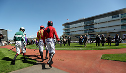 Jockeys walk out for the  Citipost Novices' Hurdle during the April Meeting at Cheltenham Racecourse