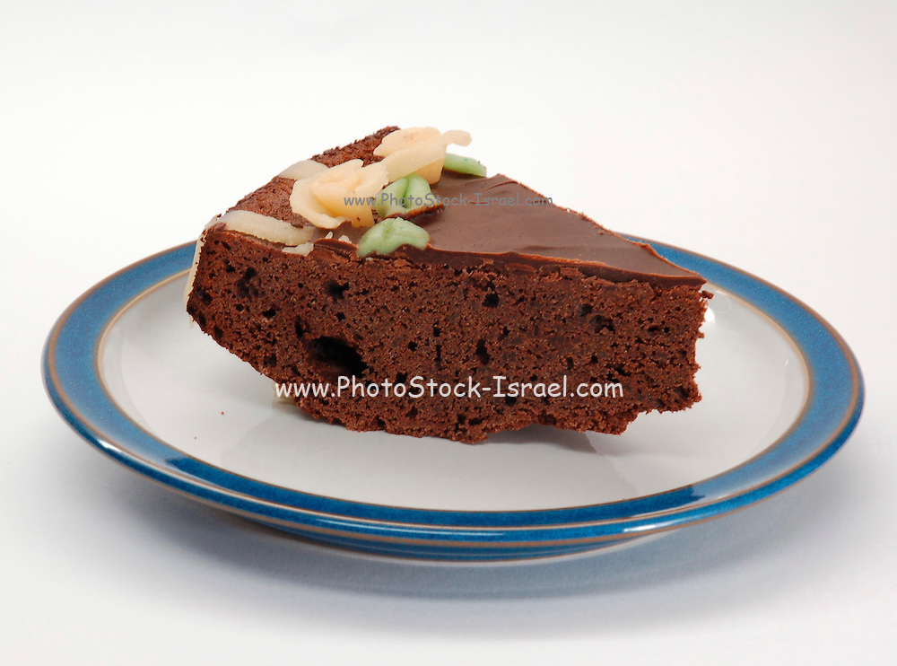 Birthday cake, a slice of chocolate cake with Marzipan decorations