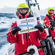 Leg 7 from Auckland to Itajai, day 08 on board MAPFRE, passing Nemo Point., Blair tuke holding the signal,  Tamara at the back 25 March, 2018.