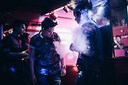 """Pattaya, April 10, 2017 - 2 tomboys smoking at the Oscar Club, The best and most popular place to meet Toms in Pattaya located off Soi Buakhao. When I first entered this place one of the many hot (and handsome) Tomboys giggled while asking me: """"Are you a Adam?""""Pattaya, 10 avril 2017 - 2 garçons manqués qui fument à l'Oscar Club, le meilleur et le plus populaire endroit pour rencontrer des Toms à Pattaya situé à Soi Buakhao. Quand je suis entré pour la première fois dans cet endroit, l'un des nombreux Tomboys chauds (et beaux) a gloussé en me le demandant : """"Es-tu un Adam ?"""""""