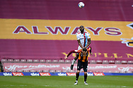 Scunthorpe United Emannuel Onariase (6) Bradford City Lee Novak (9) battles for possession during the EFL Sky Bet League 2 match between Bradford City and Scunthorpe United at the Utilita Energy Stadium, Bradford, England on 1 May 2021.